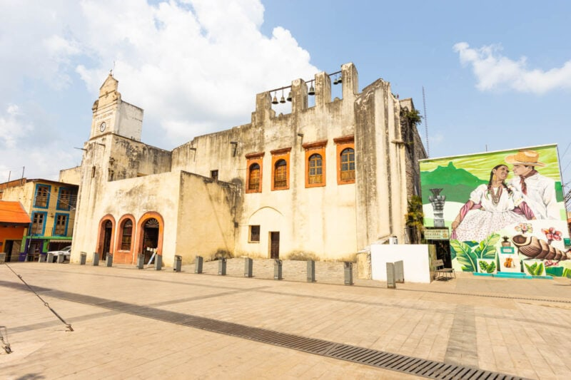 Historic pale yellow building on town square in Xilitla on a Huasteca Potosina tour