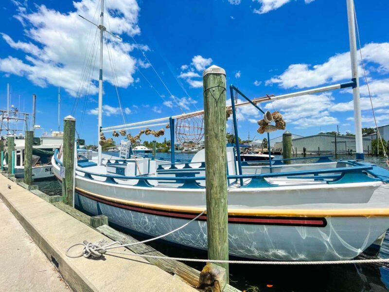 Boat tied to post in marina in Tarpon Springs