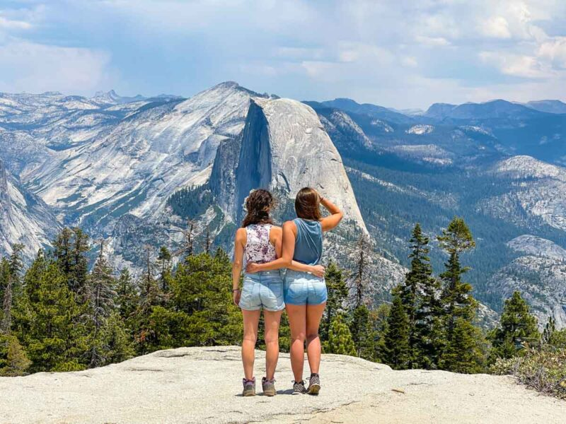 Women looking over the mountains on Yosemite road trip