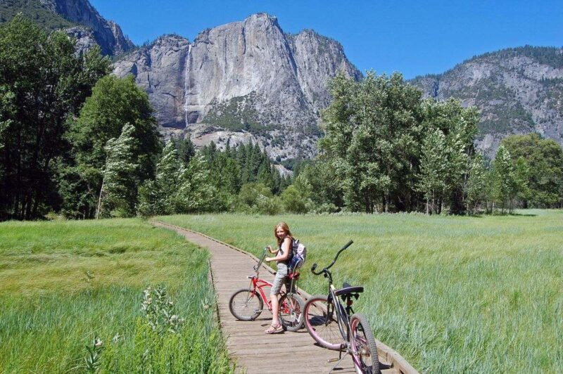 Woman cycling in front of mountains in Yosemite Valley